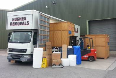 Hughes Removals van with packing materials and containers