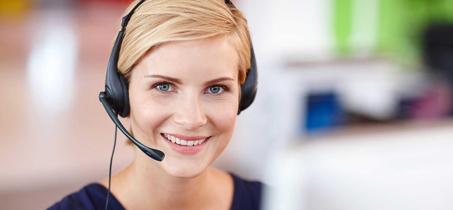Woman smiling with headset on