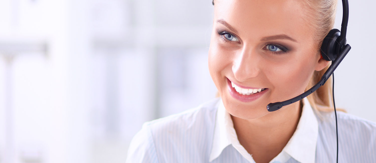 Young woman smiling with headset