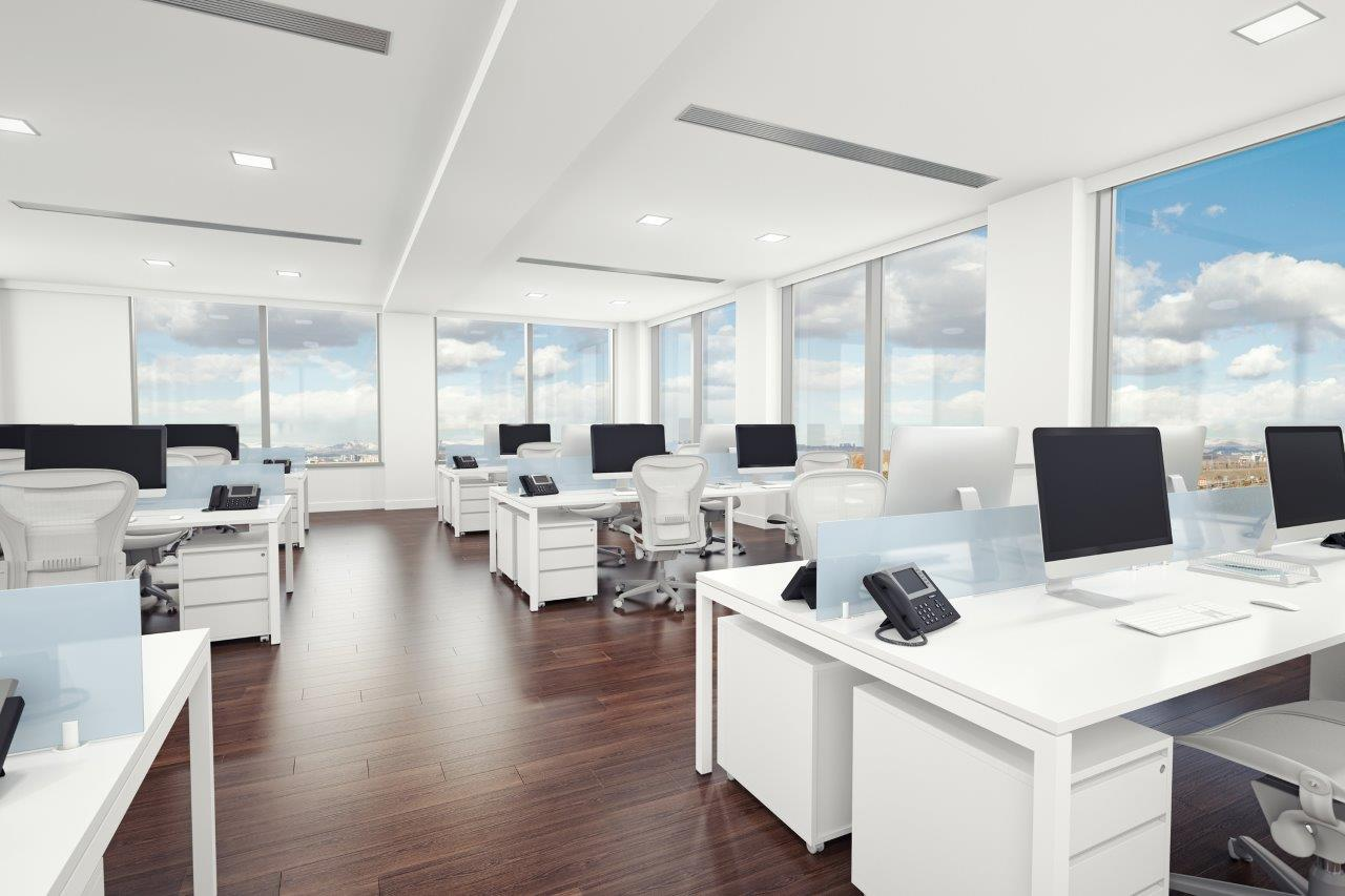 Modern looking office with desks and computers